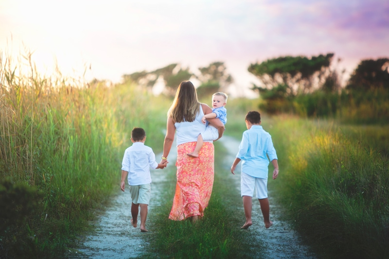Family Photographer, mother walking with 3 little boys