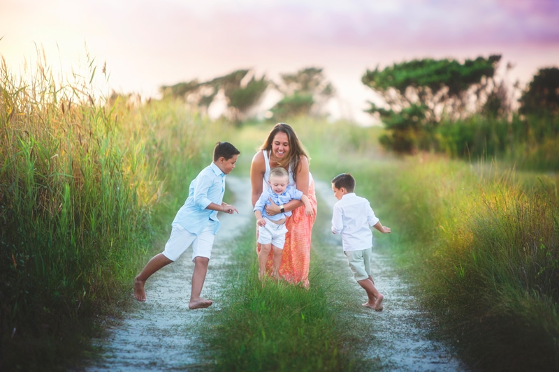 Family Photographer, mother playing with with three boys