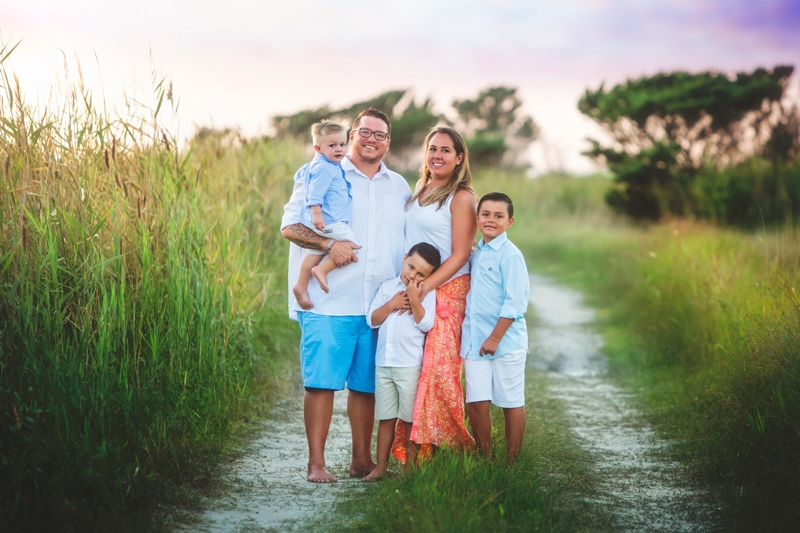 Family Photographer, family of 5 standing on an old dirt road