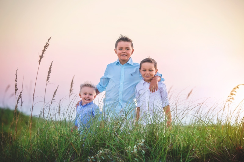 Family Photographer, three brothers standing together
