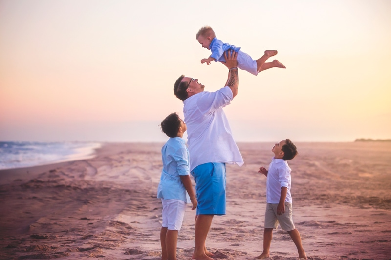 Family Photographer, father tossing littlest son into the air