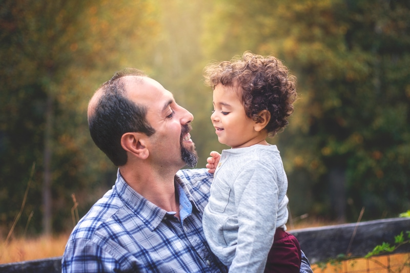Family Photographer, father and little son looking at each other