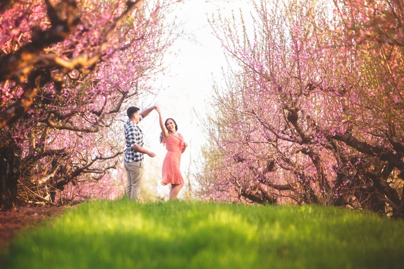 Couples Photographer, couple twirling under trees