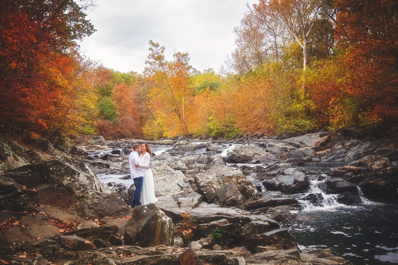 Couples Photographer, couple standing on rocks next to creek