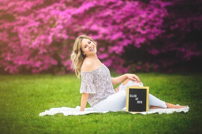 Portrait Photographer, girl senior photoshoot with letter sign