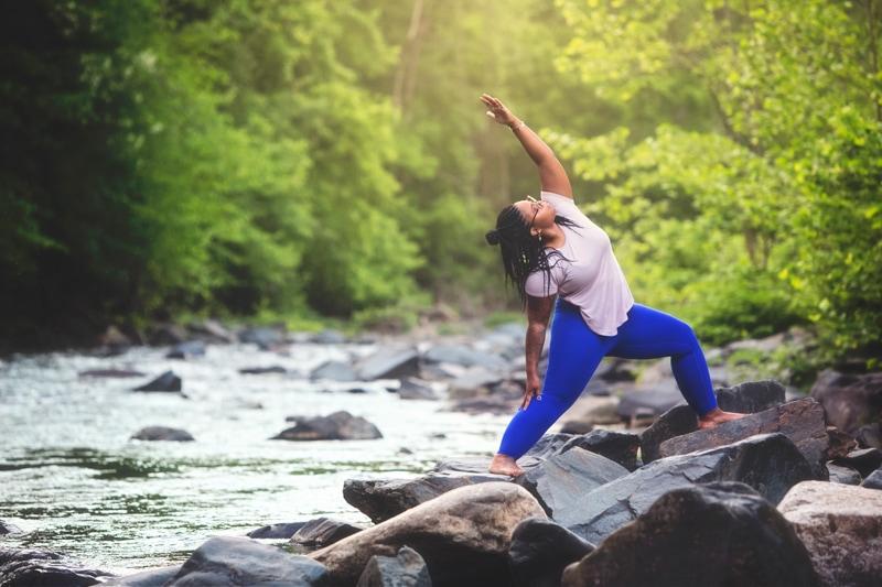 Portrait Photographer, woman doing yoga next to a creek
