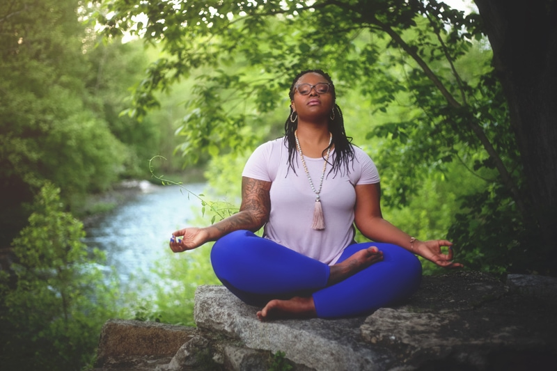 Portrait Photographer, woman meditating under a tree