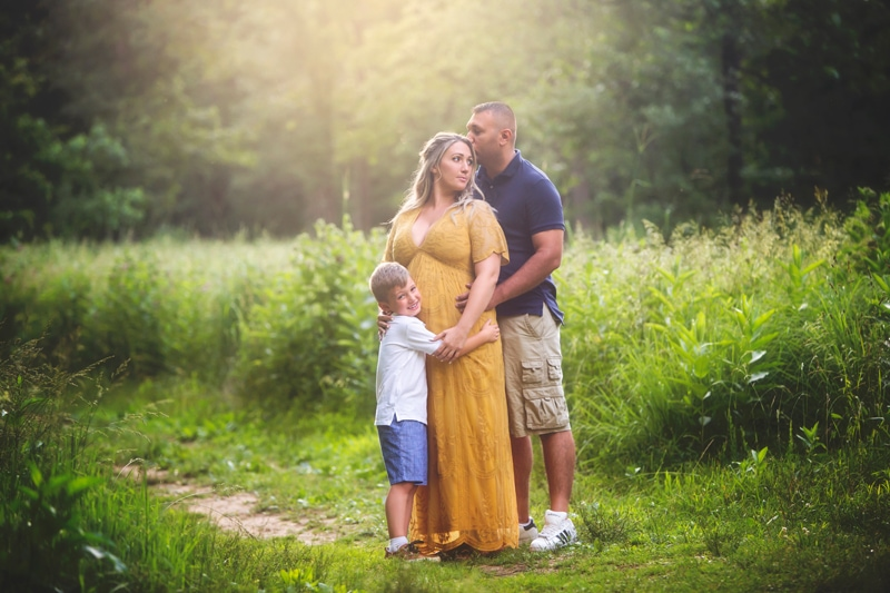 Maternity Photographer, family of three standing together