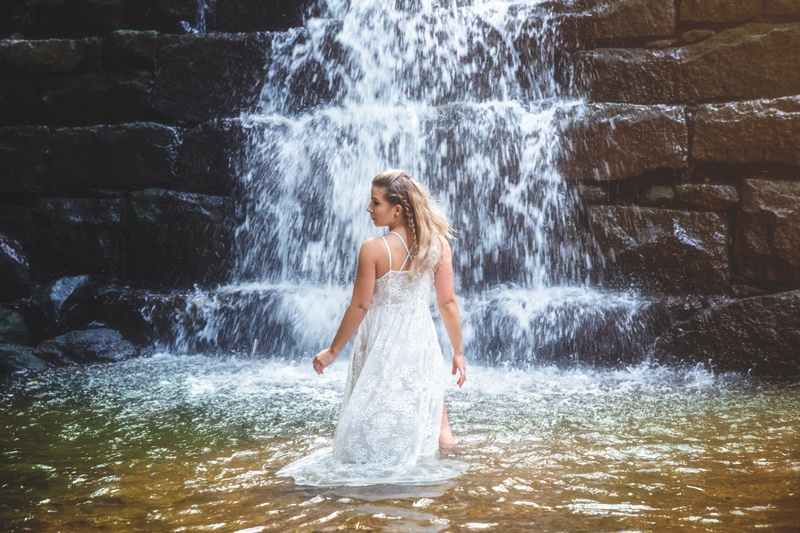 Portrait Photographer, woman twirling around in waterfall