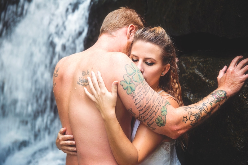 Couples Photographer, couple holding each other under a waterfall