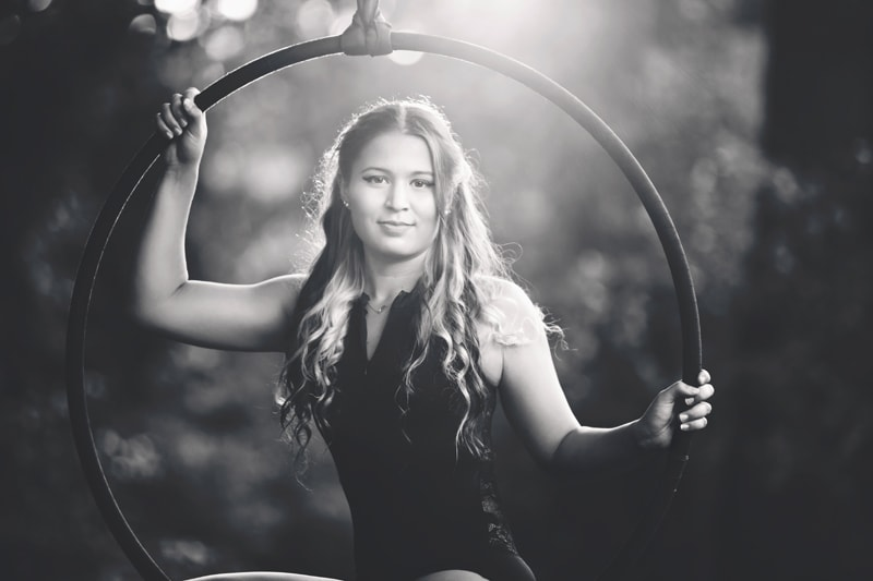 Portrait Photographer, black and white of woman sitting in a hanging hoop