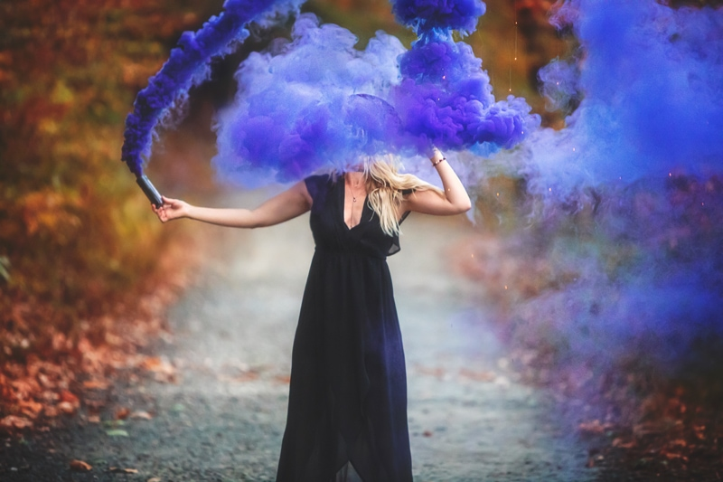 Portrait Photographer, girl playing with a purple smoke canister