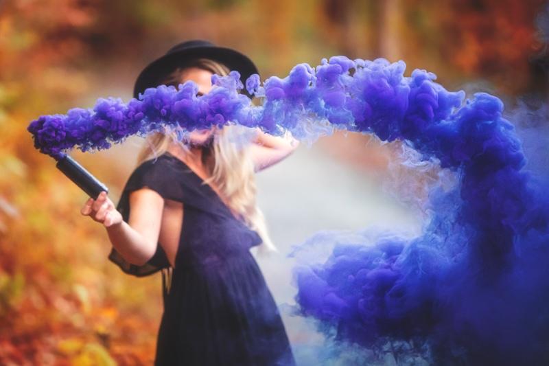 Portrait Photographer, purple smoke swirling around young woman