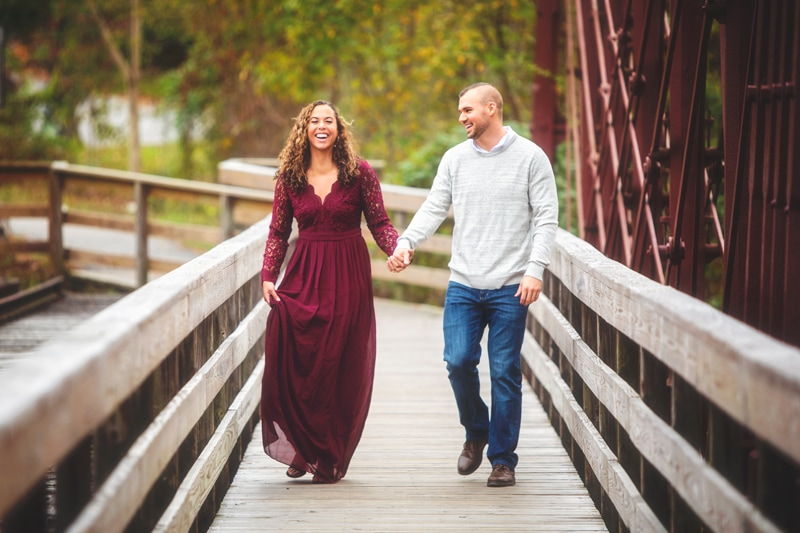 Couples Photographer, couple walking over bridge