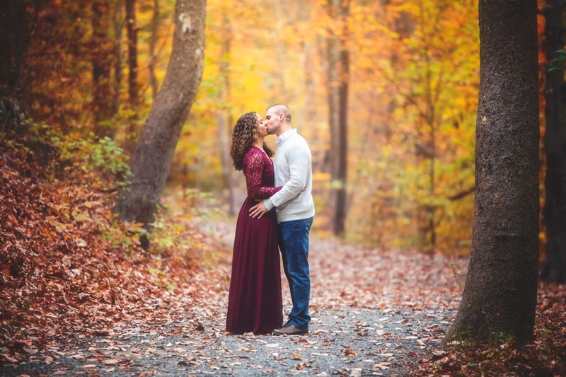 Couples Photographer, couple standing on gravel path kissing
