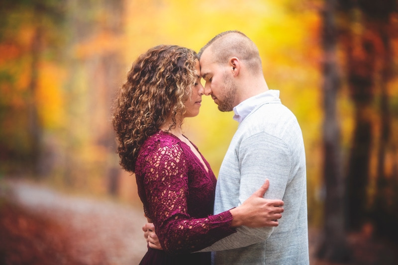 Couples Photographer, couple resting their foreheads against each other